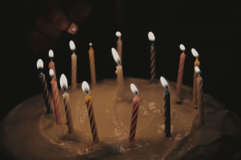 Close-Up Of Illuminated Birthday Cake
