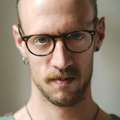 Portrait Looking At Camera Adult Front View Headshot Adults Only Only Men Human Body Part One Person One Man Only Human Face Eyeglasses  People Individuality Studio Shot Shaved Head Young Adult Real People Attitude Close-up Natural Natural Light Berlin Fresh On Market 2017 The Portraitist - 2018 EyeEm Awards The Portraitist - 2019 EyeEm Awards
