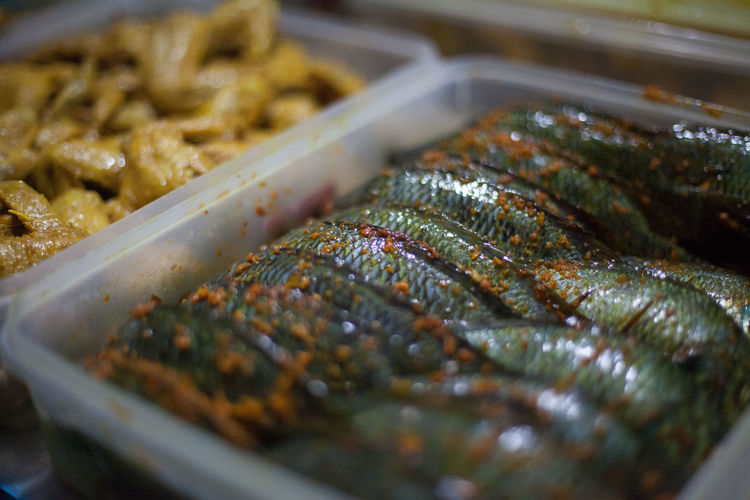 Close-Up of Marinated Fish In Container
