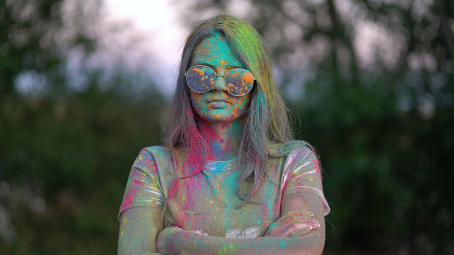 Portrait of woman with multi colored face