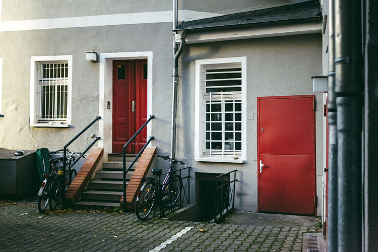Bicycles by steps against house