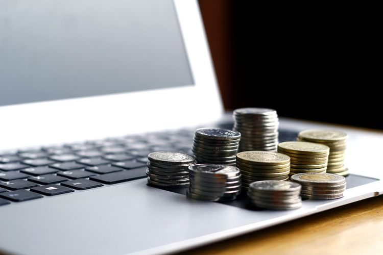 Close-up of coins on laptop