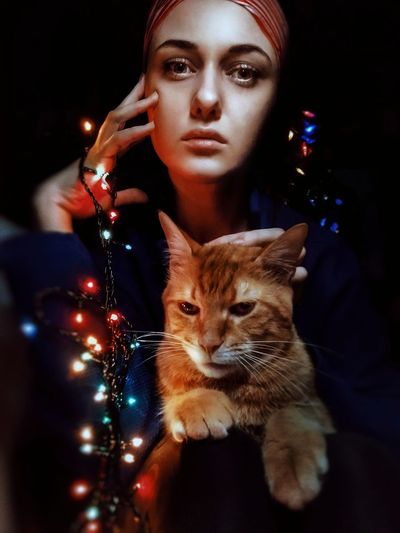 Merry Christmas and Happy New Year EyeEmReady Cat Looking At Camera Lights Portrait Pet One Person People Christmas Christmas Decoration Animal Themes EyeEm Ready   The Creative - 2018 EyeEm Awards