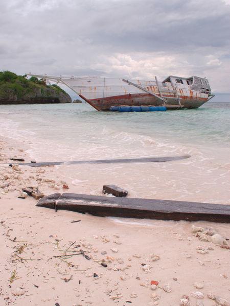 Beach Cast Away Day Isolation Moored Nature Nautical Vessel No People Outdoors Rubble Ruin Sand Sea Sky Sunken Sunken Boat Sunken Ship Transportation Water