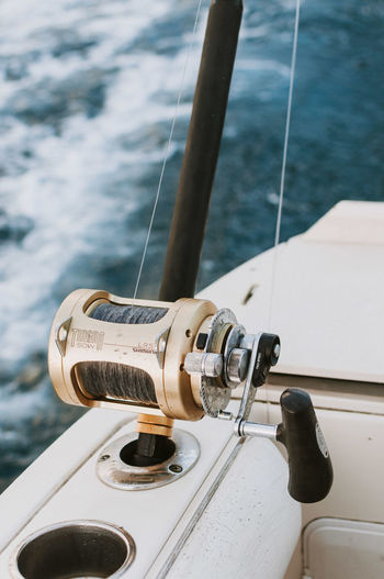 High angle view of fishing pole on boat in sea