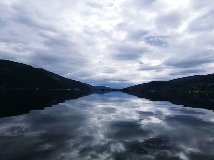 Water Lake Cloud - Sky Reflection Scenics Dramatic Sky Landscape Tranquil Scene Nature No People Outdoors Travel Destinations Sky Storm Cloud Beauty In Nature Norway🇳🇴 Horizon Over Water Beauty In Nature Tranquility Reflection