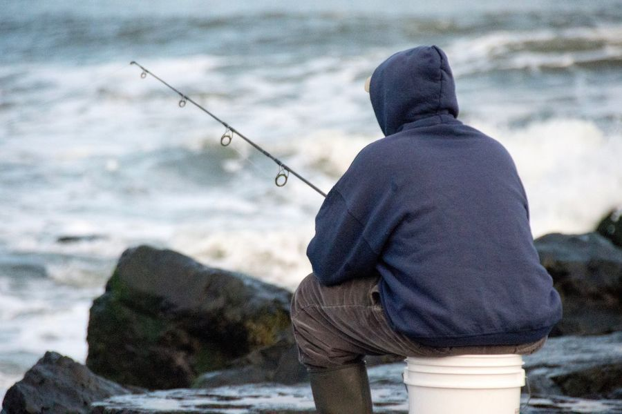 Fisherman Fish Fun Hobby Lonely Loner Man Fishing Old Man Bucket Fishing One Person Rear View Men Real People One Man Only Outdoors Day Fisherman Sea Sky People Adult Only Men Fishing Tackle Headwear Adults Only Nature Warm Clothing