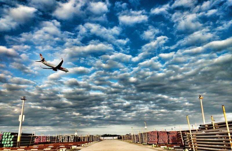 Low angle view of airplane against clouds