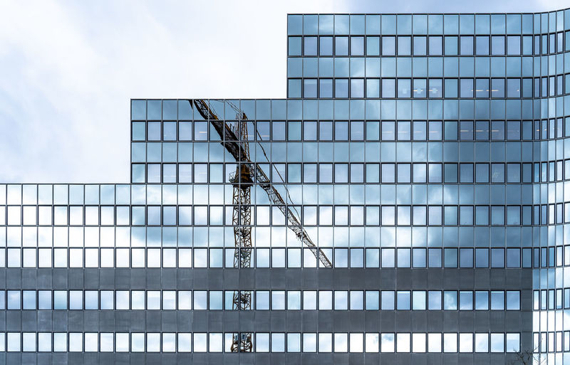 Modern Futuristic Reflection Business Finance And Industry Crane Crane - Construction Machinery Construction Symmetry Mirror Reflection Office Building Skycraper Urban Architecture Built Structure Low Angle View Building Exterior Day Sky Metal No People Cloud - Sky Outdoors Building Nature Boundary Office Glass - Material Pattern Security Office Building Exterior My Best Photo