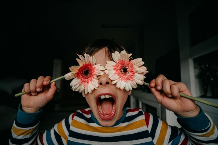 Portrait of cute girl holding flower bouquet