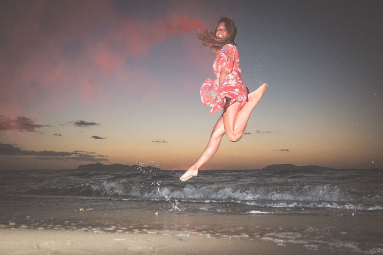 Water Sea One Person Motion Full Length Real People Leisure Activity Sky Beach Land Lifestyles Horizon Over Water Childhood Wave Nature Child Jumping Fun Outdoors