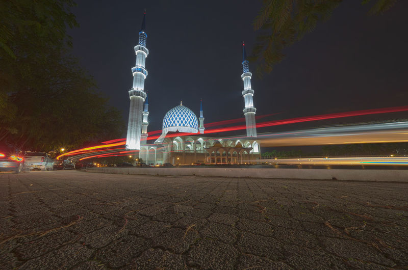 Shah Alam mosque at night with light trails. Illuminated Architecture Built Structure Night Building Exterior Light Trail Sky City Motion Long Exposure Travel Destinations Speed Tourism Building No People Travel Transportation Tower Nature Tall - High Office Building Exterior Outdoors Skyscraper