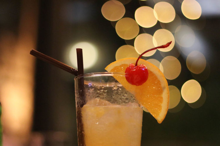 Alcohol Bokeh Close-up Cocktail Drink Drinking Glass Drinking Straw Focus On Foreground Food Food And Drink Freshness Fruit Healthy Eating Indoors  No People Red Refreshment SLICE Yellow