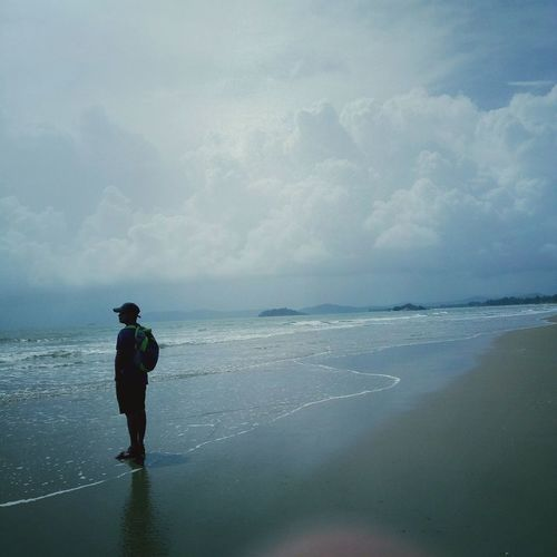 Tranquility Nature One Man Only One Person Full Length Water Beach Adult People Vacations Cloud - Sky Standing Walking Only Men Day Sea Landscape Nature Beauty In Nature Flying Over Your Imagination The Way Forward Horizon Over Water Low Angle View Sand Silhouette Lost In The Landscape