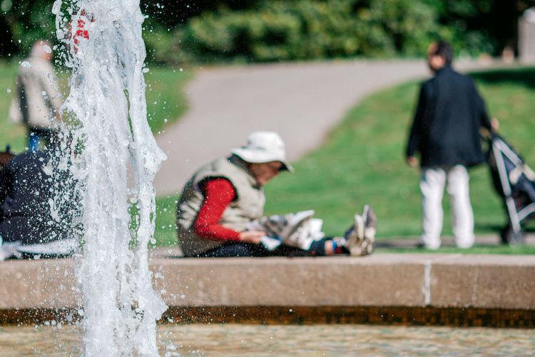 People splashing water fountain