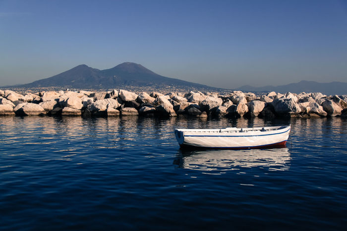Blue Blue Sky Boat Day Floating On Water Horizontal Italy Mountain Napoli Nature Neaples No People Outdoors Pedal Boat Reflection Scenics Sea And Sky Seascape Sky Tranquil Scene Tranquility Vesuvio Volcano Water