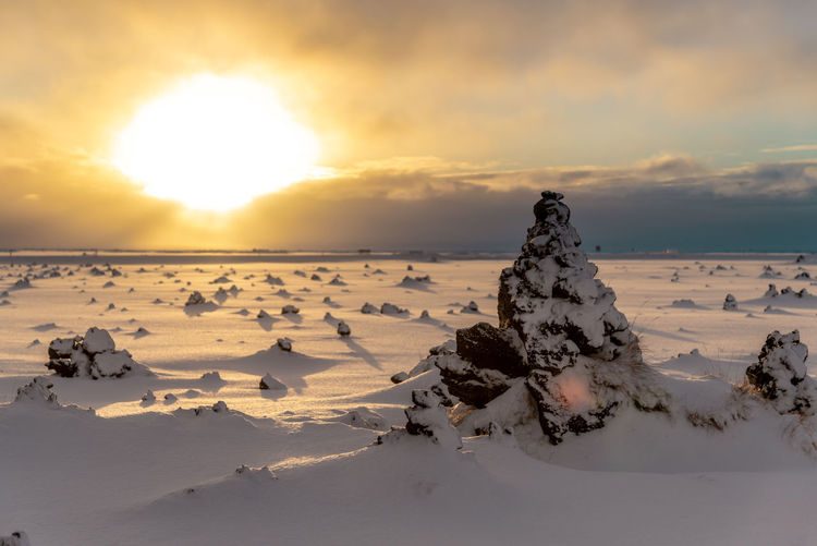 Iceland Iceland Wintertime Sunset Sky Beauty In Nature Scenics - Nature Cloud - Sky Snow Nature Tranquility Environment Tranquil Scene Winter Orange Color Landscape Cold Temperature Non-urban Scene Land Idyllic No People Sun Snowcapped Mountain Salt Flat