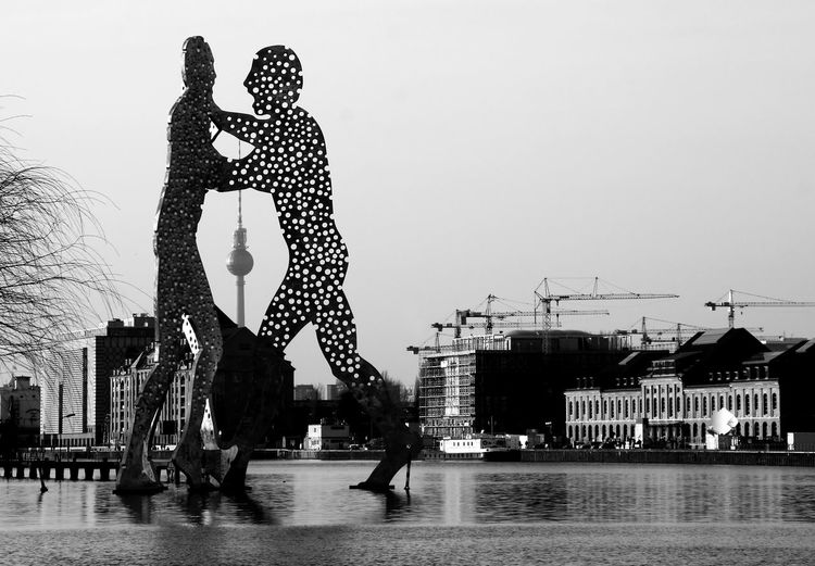 Berlin Molecule Man Treptow Berlin Molecule Man Spree Architecture Arts Culture And Entertainment Blackandwhite Bnw Building Exterior Built Structure Carousel Clear Sky Day Leisure Activity Lifestyles Modern Monochrome Outdoors Real People Sculpture Sky Treptow Water Women