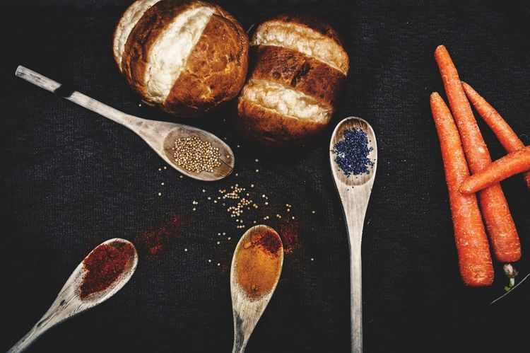 Cooking ingredients flatlay Food And Drink Food Still Life Freshness Indoors  Bread Table No People Healthy Eating Close-up Ready-to-eat Loaf Of Bread Black Background Day Cooking Carrots Spices Raw Ingredients Cooking Ingredient Poppy Tumeric Wooden Spoon