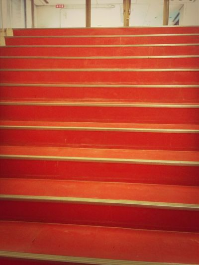 IN RED STEPS