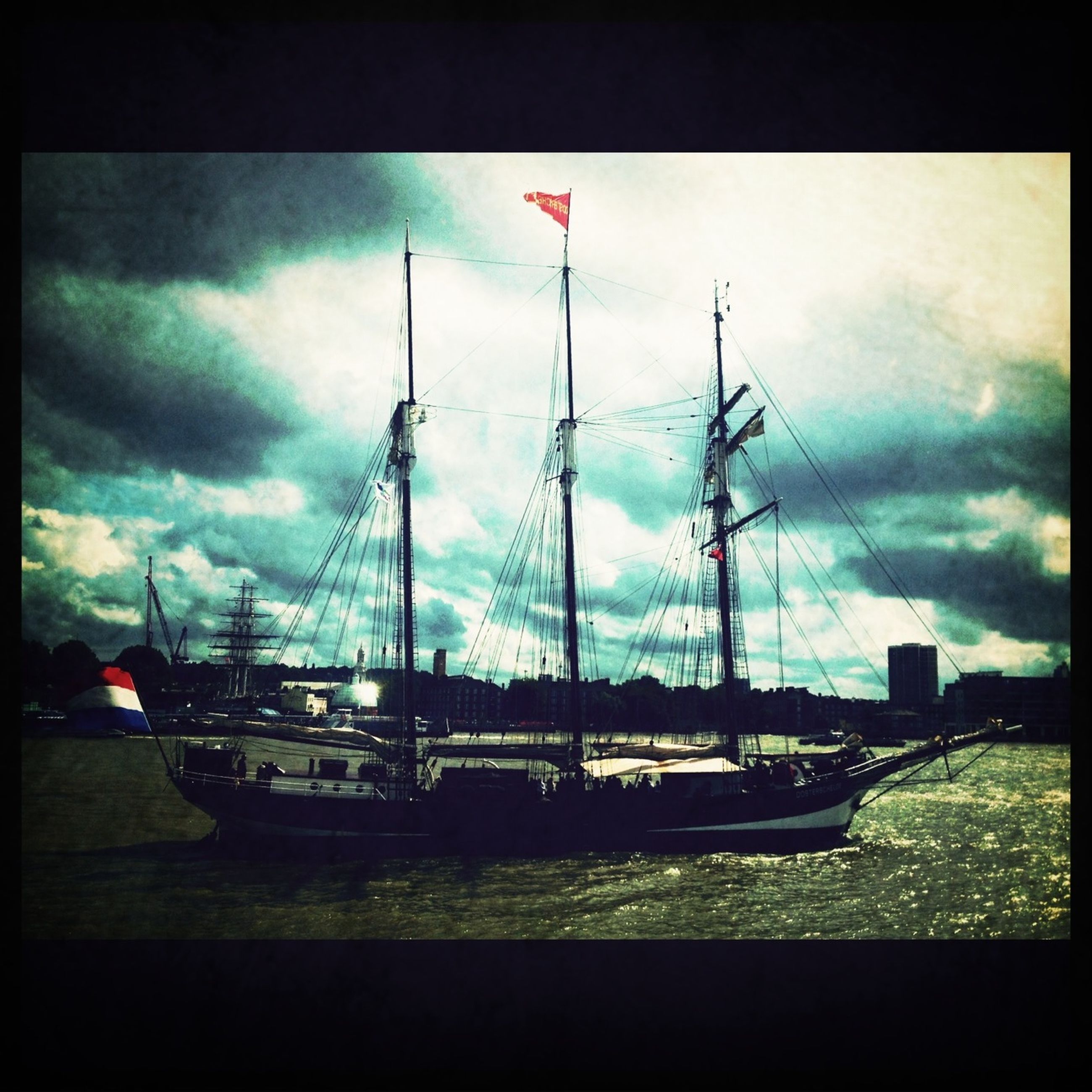 transportation, transfer print, mode of transport, nautical vessel, sky, auto post production filter, water, boat, cloud - sky, moored, cloudy, cloud, harbor, sea, mast, weather, travel, overcast, waterfront, nature