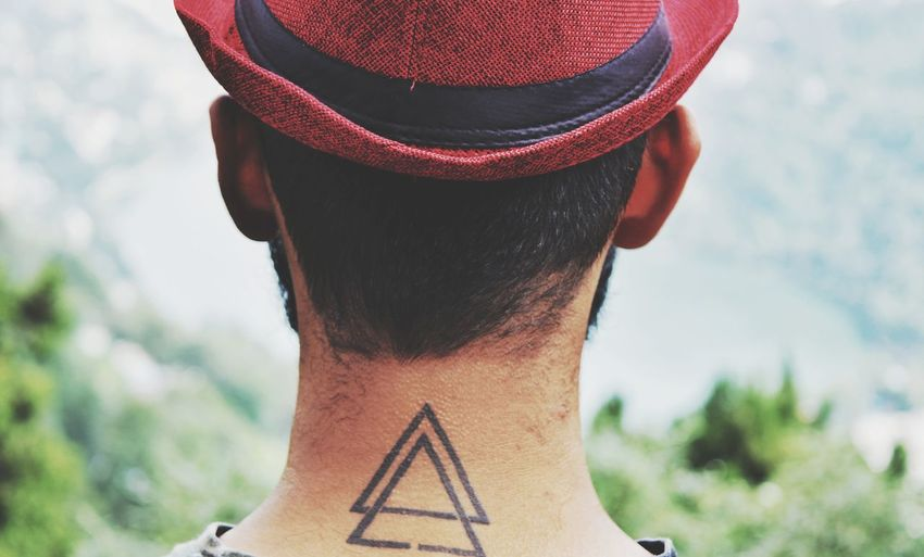 Rear view of man with tattoo on neck