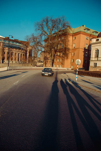 Golden hour in the most beautiful Stockholm. I went to Helsinki, Tallinn and Stockholm for Easter and truly believed I would enjoy Stockholm the least out of the three, but it blew me away. This city is gorgeous and I'd go back in a heartbeat. Crossing The Street Long Shadow - Shadow Long Shadows Golden Hour Soft Light Car Approaching Stockholm Stockholm, Sweden Beatles Shadows Light And Shadow Light Street City Life City Road Shadow Sky Travel Vehicle Diminishing Perspective City Street