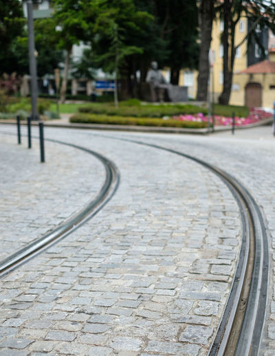 Transportation City Street Track Focus On Foreground Footpath Architecture Tree Railroad Track Direction Mode Of Transportation The Way Forward Cobblestone Day Plant Built Structure No People Building Exterior Rail Transportation Outdoors Paving Stone Tram Tracks