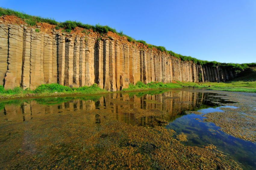 Magnificent basalt walls, wide and beautiful landscape. Magnificent Natural Rock Formation Rock Wall Taiwan Basalt Basalt Columns Basalt Rock Beauty In Nature Broadcasting Day Lake Landscape Nature No People Outdoors Peaceful Penghu Sky Water