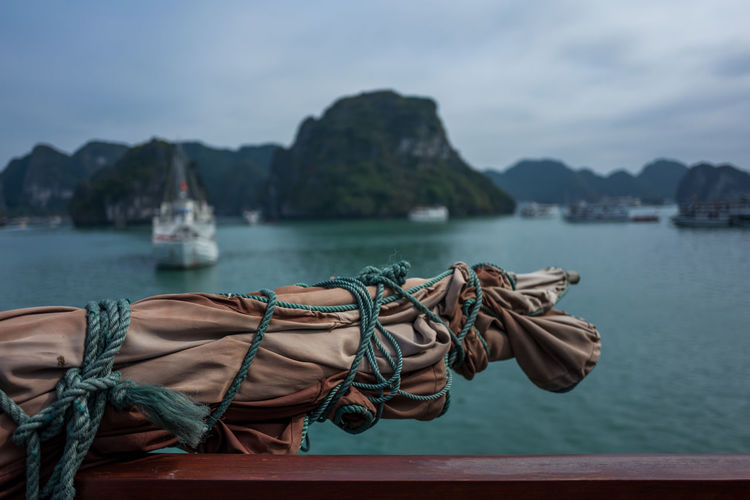 Ha Long Bay, Vietnam Bay Beauty In Nature Cloud - Sky Day Focus On Foreground Mode Of Transportation Moored Mountain Nature Nautical Vessel No People Outdoors Rope Sea Sky Tied Up Transportation Travel Travel Destinations Water