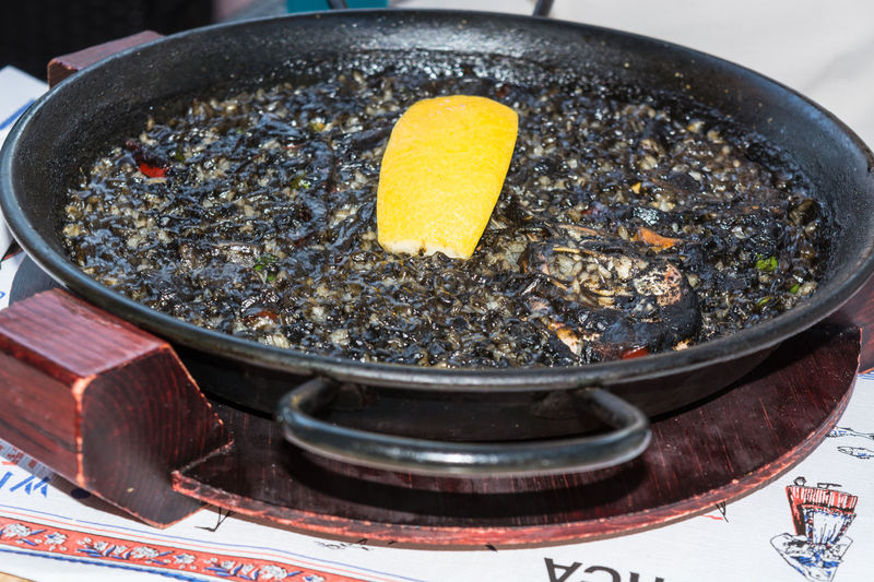 Arroz Negro black paella with seafood in a Paellera. Paella Arroz Negro Black Paella Day No People Outdoors Shrimp;
