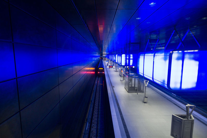 U-Bahnhof HafenCity Universität The Architect - 2018 EyeEm Awards Architecture Arrival Blue Ceiling Illuminated Indoors  Light Lighting Equipment Mode Of Transportation Motion Night No People Public Transportation Rail Transportation Railroad Station Railroad Station Platform Railroad Track Station Subway Train Track Train Train - Vehicle Transportation Travel