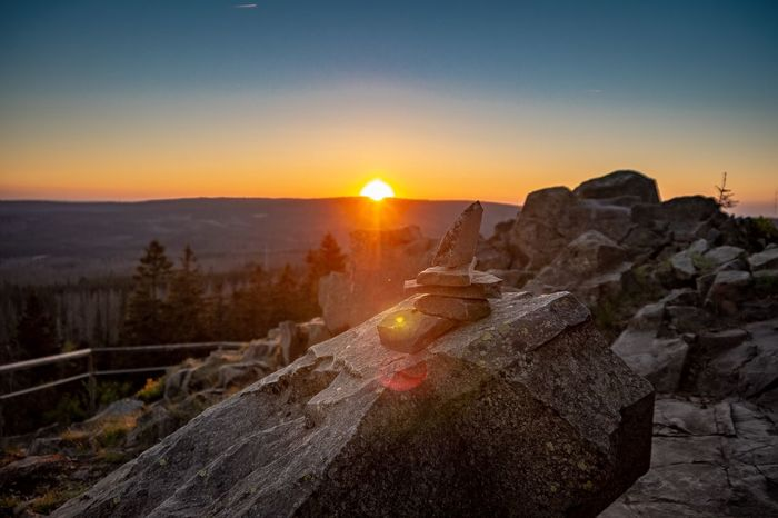Sunset Sky Sunset Nature Scenics - Nature Beauty In Nature Sun Orange Color Land Sunlight Mountain Landscape Outdoors Plant No People Clear Sky Lens Flare Environment Idyllic Tranquility Tranquil Scene