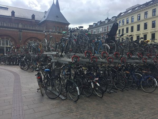 Bike Station Bicycle Architecture Building Exterior Built Structure Transportation Mode Of Transport Mobility In Mega Cities Outdoors Sky Land Vehicle Bicycle Rack City No People Day Stationary Cloud - Sky