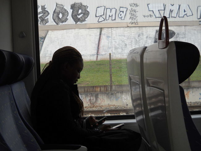 2012 Casual Clothing Day France Glass - Material Mode Of Transport Near Carcassone On The Train Passenger Person Phones Public Transportation Seat Side View Sitting Transportation Travel Vehicle Interior Vehicle Seat Window