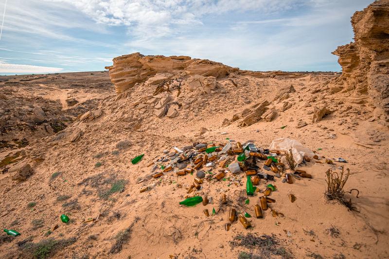 Scenic view of desert land against sky