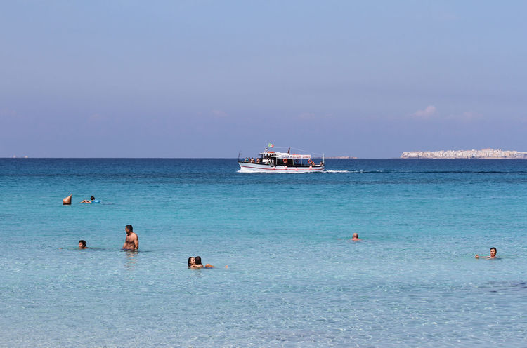Bather's Beach Salento Puglia Salento, Italy Bathers Beach Beauty In Nature Blue Horizon Over Water Nautical Vessel Punta Della Suina Sea Sky Summer Travel Travel Destinations Vacations Water Boat On Sea Boat Boat On Water Boat On The Sea Serenity People Bath In The San