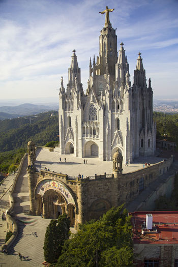 Church of the Sacred Heart Arch Architecture Built Structure Capital Cities  Church City Cloud Cloud - Sky Day Famous Place History Outdoors Sky Society From Above Statue Statue Of Jesus Temple Tibidabo Tibidabo's Church Tourism Travel Destinations Feel The Journey A Bird's Eye View