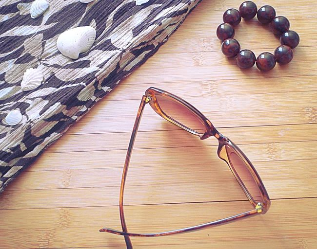 Accessories Arrangement Beach Accessories Bracelet Bridge Brown Close-up No People Selfie Shells Still Life Sunglasses Table Tan Water Wood - Material Wooden summer
