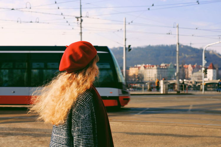 Woman Wearing Red Hat While Standing On Street In City
