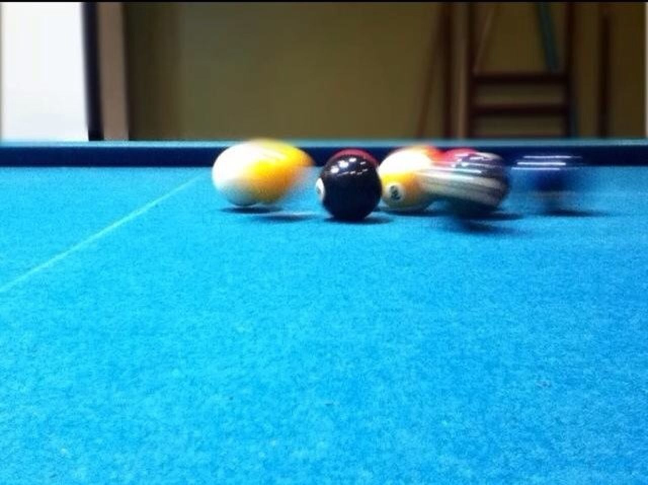 sport, pool ball, indoors, motion, ball, pool table, sports equipment, blurred motion, pool - cue sport, leisure activity, no people, snooker ball, close-up, snooker, day, pool cue