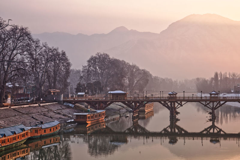 Bridge over river against sky during sunrise, srinagar kashmir
