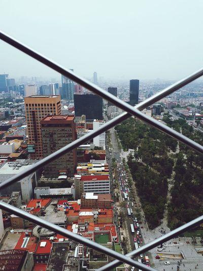 #torrelatinoamericana #mexico #mexicocity #smog #City #citylife City Cityscape Urban Skyline Modern Skyscraper Bridge - Man Made Structure City Life High Angle View Sky Architecture