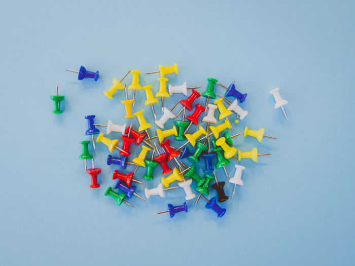 Set of push pins in different colors with real shadows on a pastel background. Backgrounds Business Close-up Colorful Concept Equipment Large Group Of Objects Multi Colored No People Office Paper Pastel Colors Pins Push Pins School Studio Shot Thumbtack Variation Work