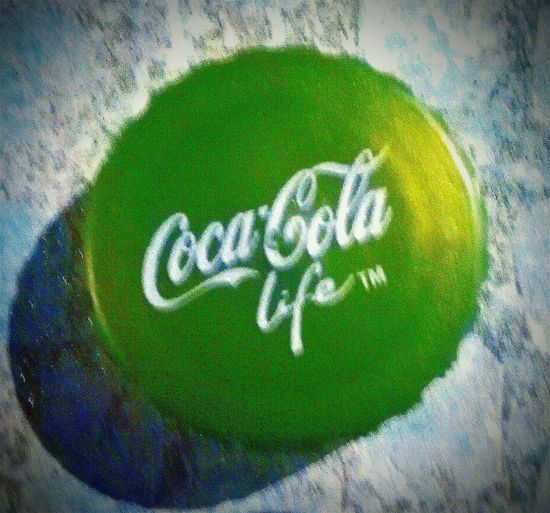 It's The Real Thing! Drink Soda Coke™ Coke Adds Life Things Go Better With Coke WhiteText White And Green Green And White CursiveText Bottle Top Text Life Trademark Trademark™ ™ Close-up Coca-cola CokeBottleCaps Coke Soft Drink Bottle Caps Bottlecaps Bottle Caps Bottle Cap Coca~Cola ® Life™ Coca~Cola, Life ® Coca~Cola, Life™ Information Western Script