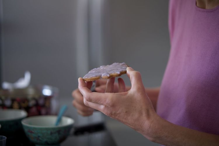 Close-up of hand holding cookie