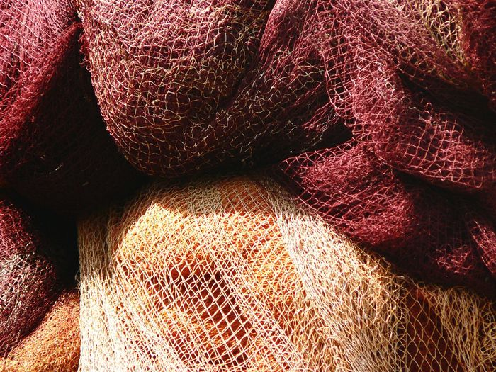 Close-up of used colorful fishing net.