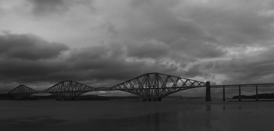 The forth rail bridge in stormy weather Bridge - Man Made Structure Connection Sky Cloud - Sky Engineering Architecture Transportation Built Structure No People Outdoors Travel Destinations Water Bridge Suspension Bridge Day Sea Storm Cloud Nature