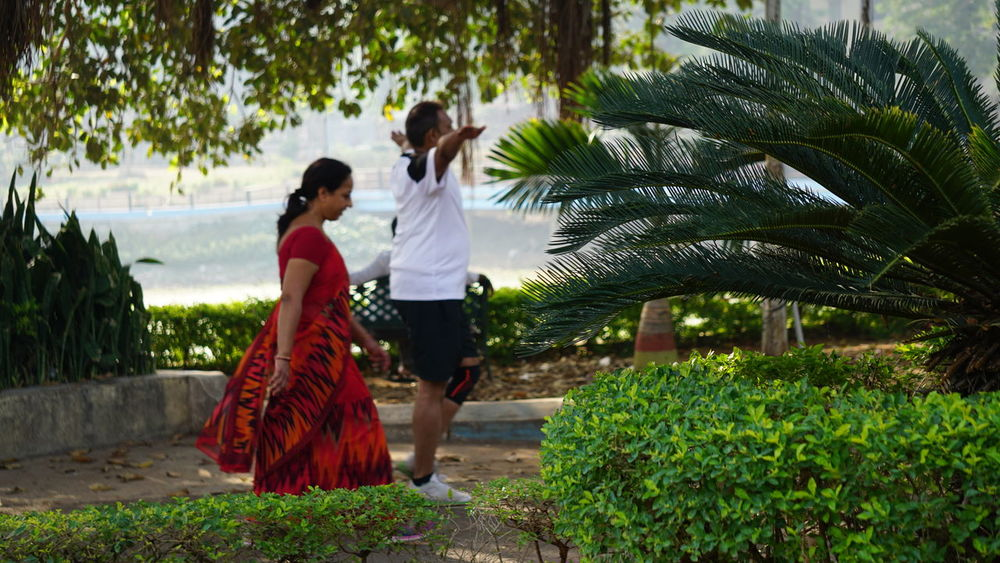 Movement is life : Keep Moving Women Traditional Clothing Young Adult Young Women Love Tree Togetherness Adult Two People Full Length People Formalwear Beauty Day Outdoors Male And Female Red Saree Greenery Morning Walk Healthy Lifestyle Fitness Psychological Strength Stress Reliever Sony Alpha A6000 Nwin Photography