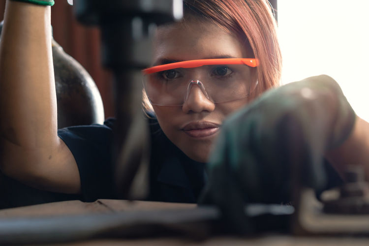 Close-up of woman working in factory